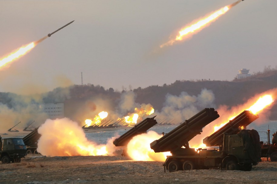 "This undated picture released from North Korea's official Korean Central News Agency (KCNA) on March 25, 2016, shows the large-scale intensive striking drill of long-range artillery pieces of the KPA large combined units at an undisclosed location in North Korea. / AFP / KCNA VIA KNS / KCNA / REPUBLIC OF KOREA OUT   ---EDITORS NOTE--- RESTRICTED TO EDITORIAL USE - MANDATORY CREDIT ""AFP PHOTO/KCNA VIA KNS"" - NO MARKETING NO ADVERTISING CAMPAIGNS - DISTRIBUTED AS A SERVICE TO CLIENTS/ THIS PICTURE WAS MADE AVAILABLE BY A THIRD PARTY. AFP CAN NOT INDEPENDENTLY VERIFY THE AUTHENTICITY, LOCATION, DATE AND CONTENT OF THIS IMAGE. THIS PHOTO IS DISTRIBUTED EXACTLY AS RECEIVED BY AFP.   /"