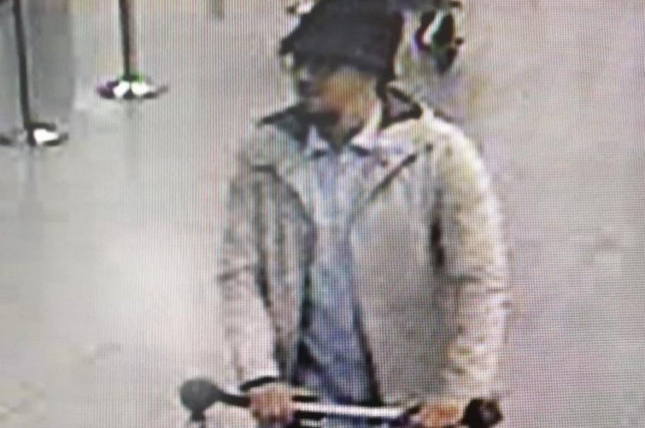 "A handout image released on March 22, 2016 by the Belgian Federal Police on demand of the Federal prosecutor shows a screengrab of the airport CCTV camera showing a suspect of this morning's attacks at Brussels Airport, in Zaventem, pushing a trolly with suitcases. A series of explosions claimed by the Islamic State group ripped through Brussels airport and a metro train today, killing around 35 people in the latest attacks to bring bloody carnage to the heart of Europe. / AFP / BELGIAN FEDERAL POLICE / HO /  - Belgium OUT / RESTRICTED TO EDITORIAL USE - MANDATORY CREDIT ""AFP PHOTO / BELGIAN FEDERAL POLICE"" - NO MARKETING NO ADVERTISING CAMPAIGNS - DISTRIBUTED AS A SERVICE TO CLIENTS"