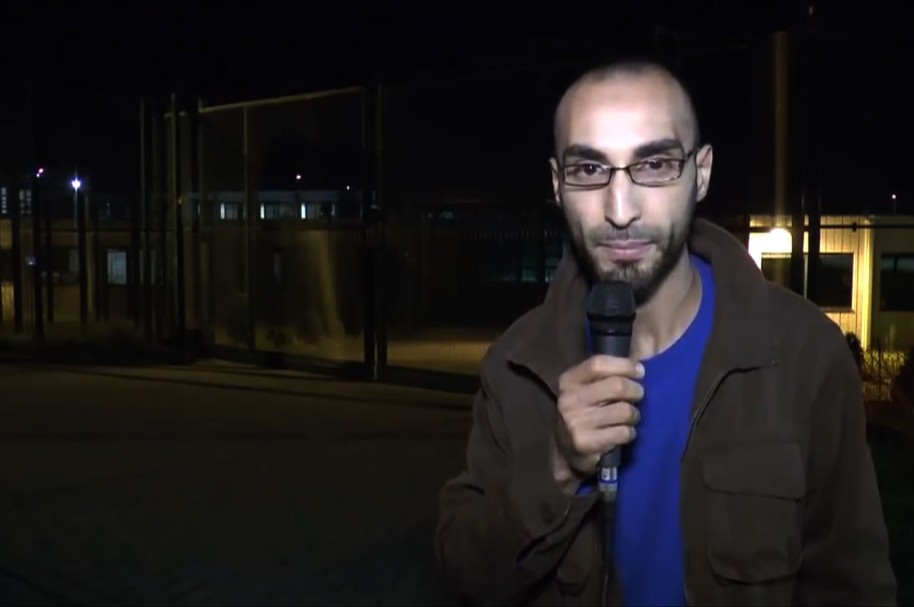 """This video grab made on March 26, 2016 from a video posted on YouTube in 2014 shows Faycal Cheffou, then calling himself an independent journalist demanding the authorities to respect the rights of asylum-seekers, and identified on March 26, 2016 by Belgium federal prosecutor as one of the main suspects of the March 22 Brussels attacks and charged with terrorist murder. Faycal Cheffou, believed to be the """"man in a hat"""" pictured in CCTV footage alongside the two airport bombers, but whose device did not go off, is the first person to face terrorist offences over the bloodiest attacks ever to strike the symbolic capital of Europe. / AFP / Youtube / - / DATE AND PLACE UNIDENTIFIED BY AFP == VIDEO POSTED ON YOUTUBE BY FAYCAL CHEFFOU IN 2014 == RESTRICTED TO EDITORIAL USE - MANDATORY CREDIT """"AFP PHOTO / YOUTUBE""""- NO MARKETING NO ADVERTISING CAMPAIGNS - DISTRIBUTED AS A SERVICE TO CLIENTS =="""