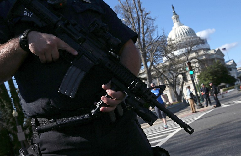 "WASHINGTON, DC - MARCH 28: Heavily armed U.S. Capitol police stand guard outside the U.S. Capitol after at least one person was shot in the Capitol Visitor Center March 28, 2016 in Washington, DC. The Capitol was placed in ""lock down"" following the shooting.   Win McNamee/Getty Images/AFP"