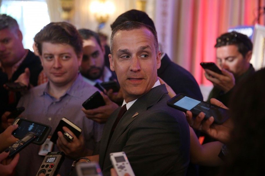 (FILES) This file photo taken on March 10, 2016 shows Corey Lewandowski campaign manager for Republican presidential candidate Donald Trump speaking with the media before former presidential candidate Ben Carson gives his endorsement to Mr. Trump at the Mar-A-Lago Club in Palm Beach, Florida. Donald Trump's presidential campaign manager Corey Lewandowski was charged March 29, 2016 with battery for allegedly roughly grabbing a reporter earlier this month, police in Florida said. Lewandowski is accused of grabbing a female reporter, Michelle Fields, so hard that it left bruises on her arm, at a news conference by the Republican frontrunner in Florida on March 8.  / AFP / GETTY IMAGES NORTH AMERICA / JOE RAEDLE