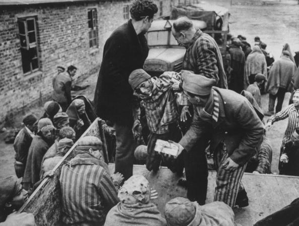American soldiers liberating prisoners from the Nazi concentration camp at the end of WWII.  (Photo by Time Life Pictures/National Archives/The LIFE Picture Collection/Getty Images)
