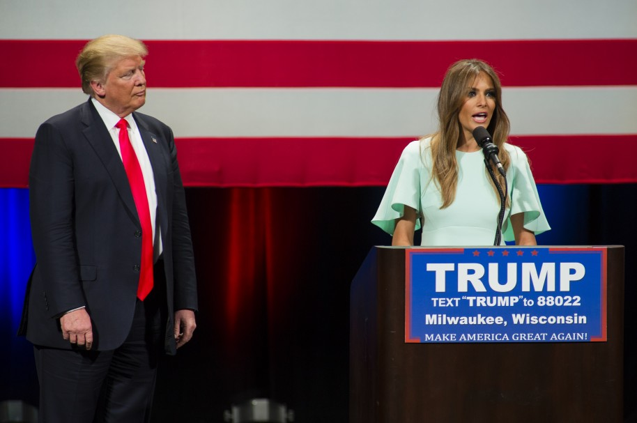MILWAUKEE, WI - APRIL 04: Republican presidential candidate Donald Trump listens to his wife Melania Trump speak to supporters at a campaign stop on April 4, 2016 in Milwaukee, Wisconsin. Candidates are campaigning in Wisconsin the day before the Tuesday April 5th primary.   Darren Hauck/Getty Images/AFP