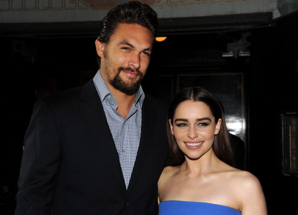 "HOLLYWOOD, CA - MARCH 18: Actors Jason Momoa (L) and Emilia Clarke arrive at the premiere of HBO's ""Game Of Thrones"" Season 3 at TCL Chinese Theatre on March 18, 2013 in Hollywood, California. (Photo by Kevin Winter/Getty Images)"