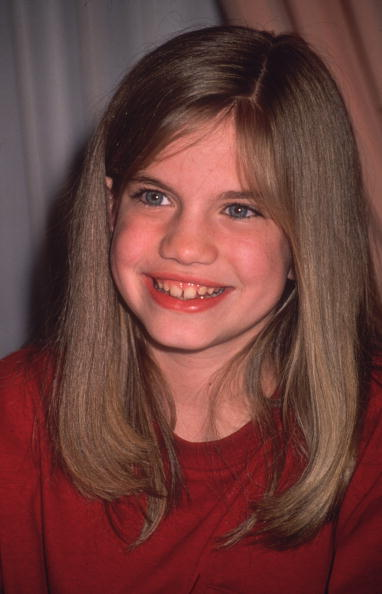 circa 1995: Candid headshot of American actress Anna Chlumsky smiling. (Photo by Fotos International/Getty Images)