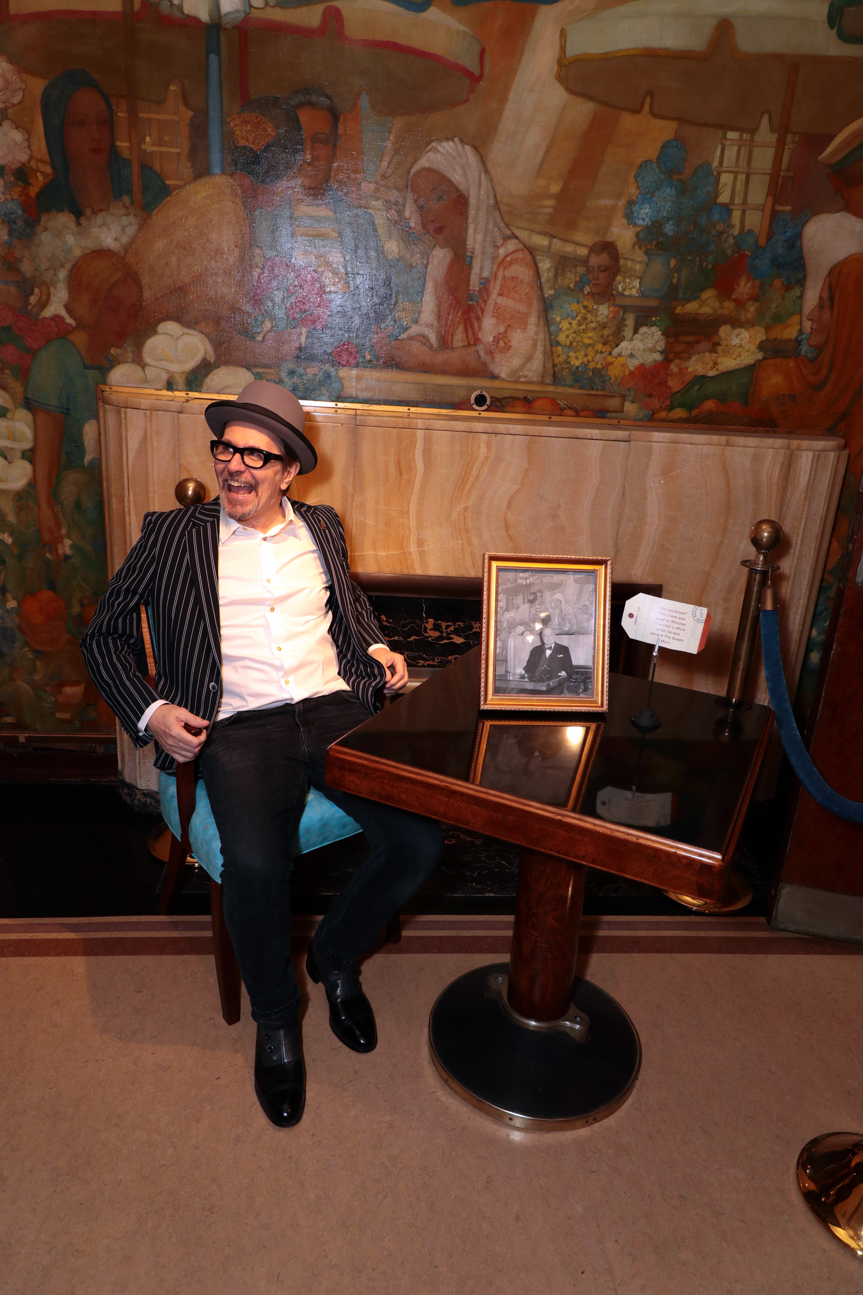 Gary Oldman having a great time at the Their Finest Hour exhibit in The Queen Mary