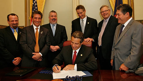 Governor Andrew Cuomo signs the freedom to marry into law, June 2011