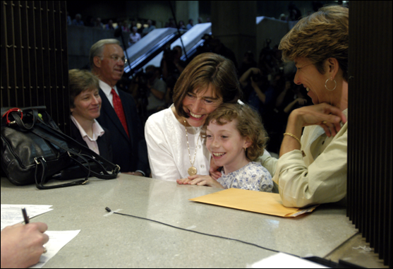 Julie and Hillary Goodridge, named plaintiffs in the Massachuestts victory, at last marry with their daughter and attorney Mary Bonauto looking on.