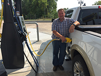 Scott_McPheeters_ACE_board_Member_fills_up_with_first_tank_at_Blue_Heron.JPG#asset:125035