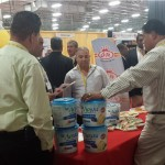 BD - World of the Latino Cuisine Trade Show - Photo - Aviva crackers making a big sale at 2014 Event