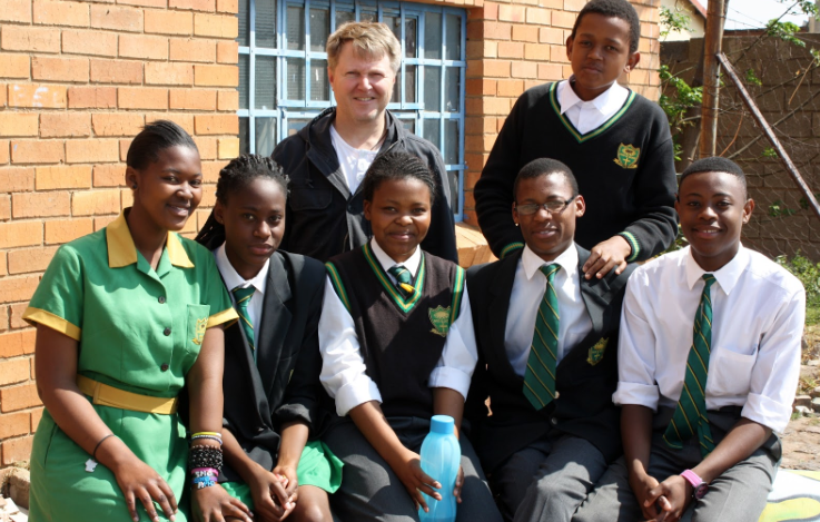 Fr. Bruce Botha, S.J. with students of St. Martin de Porres
