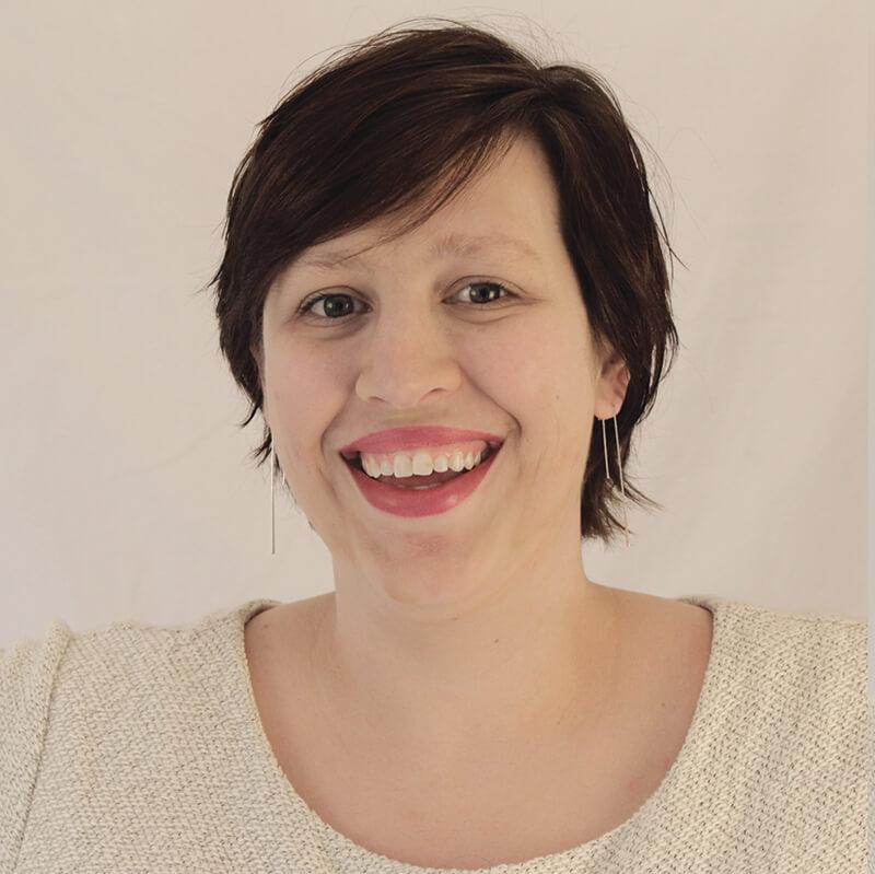 A striking headshot of our staff member Ashley Brassea
