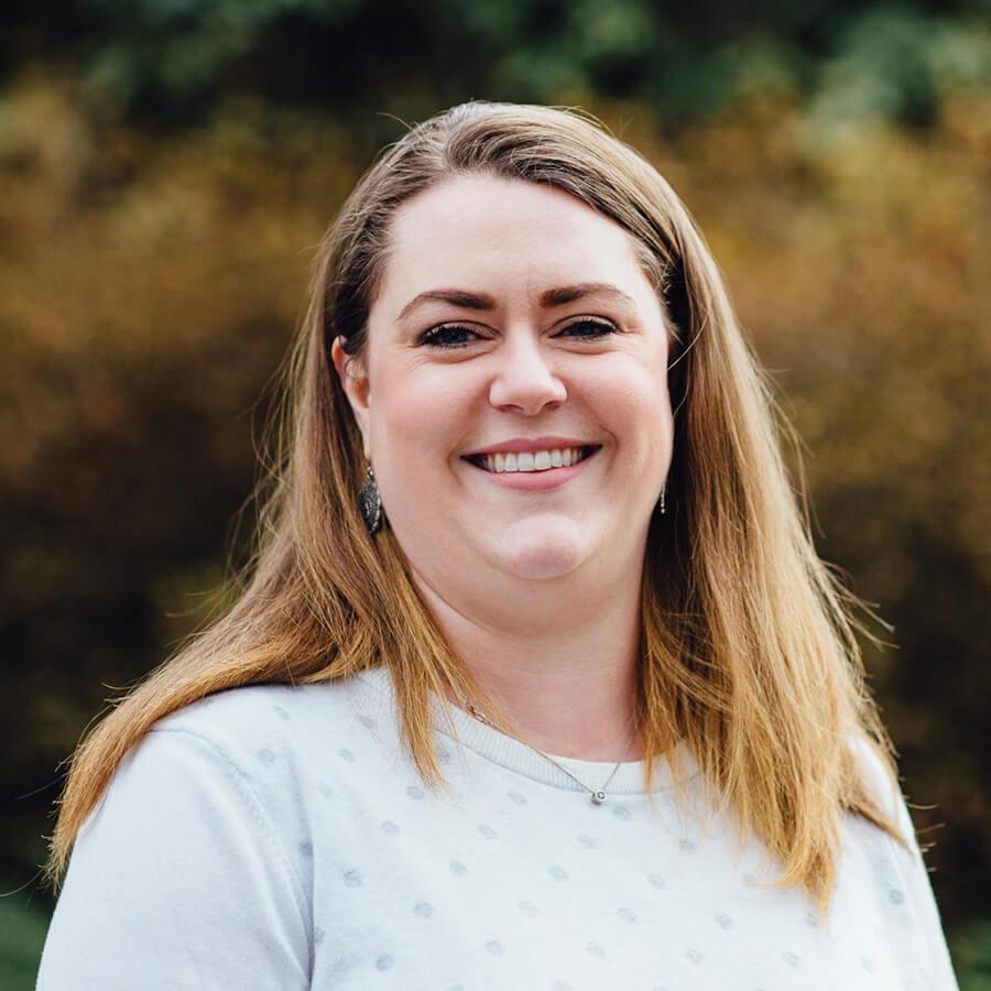 A striking headshot of our staff member Jen Alvarado