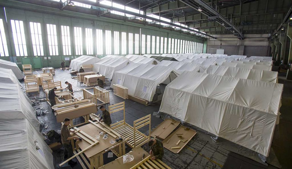 The former Tempelhof Airport in Berlin is now home to more than 2,000 refugees.