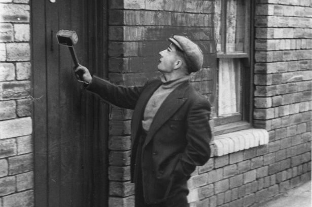 A knocker-up demonstrating another favoured means of waking not just their customer but the entire neighbourhood.