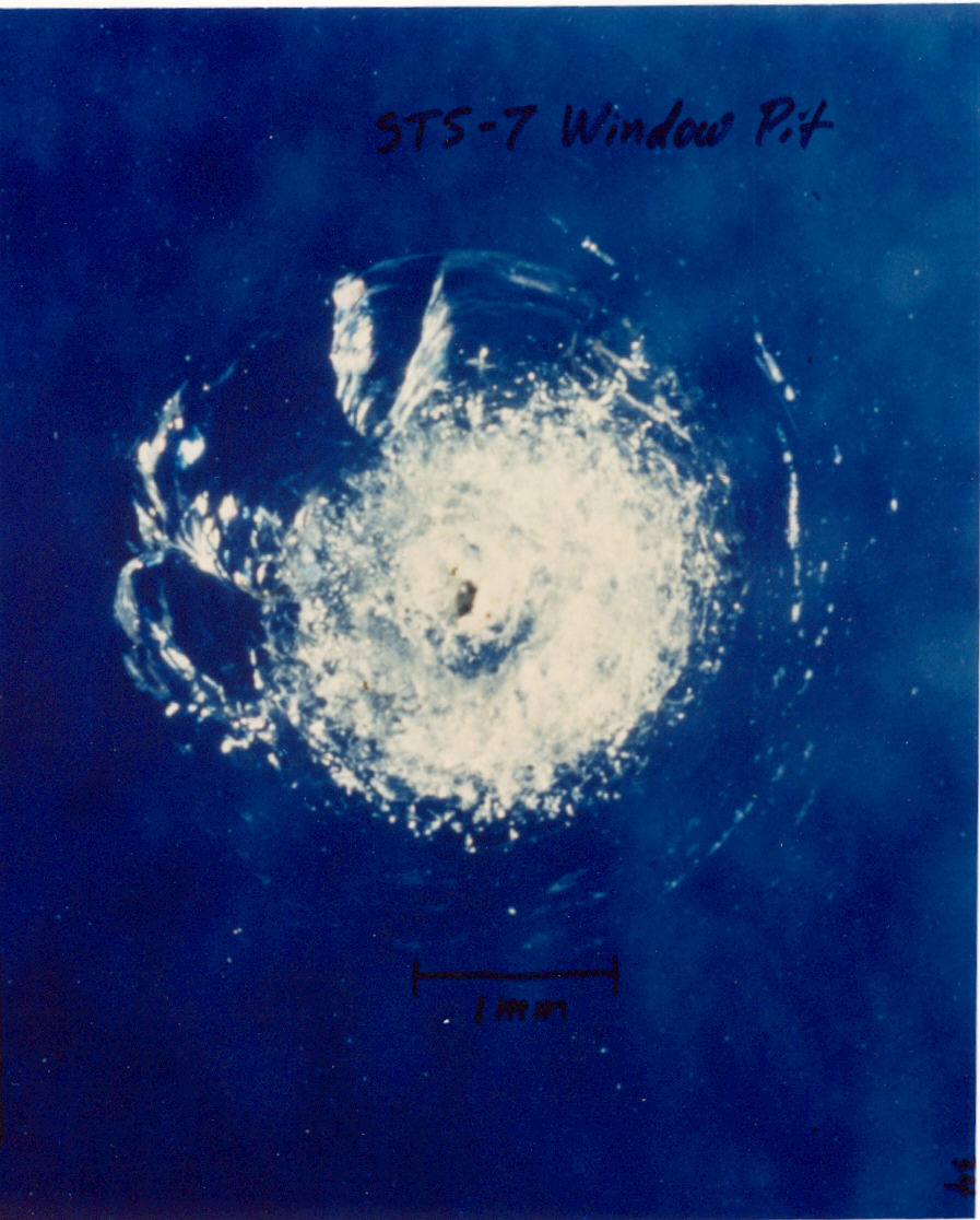 Damaged Window on the Challanger Shuttle from Space Debris