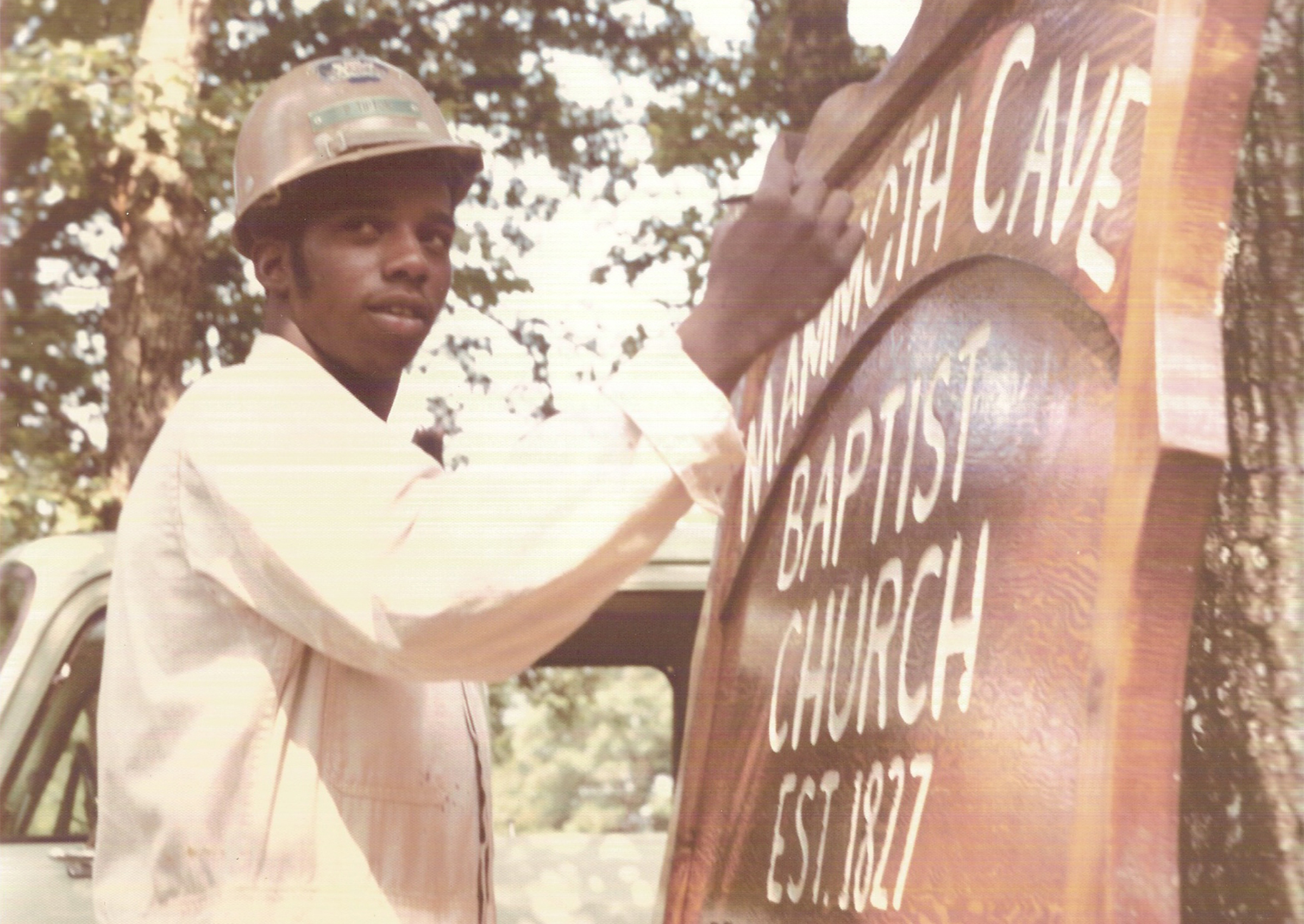 A Great Onyx Job Corps student paints a sign for a local church