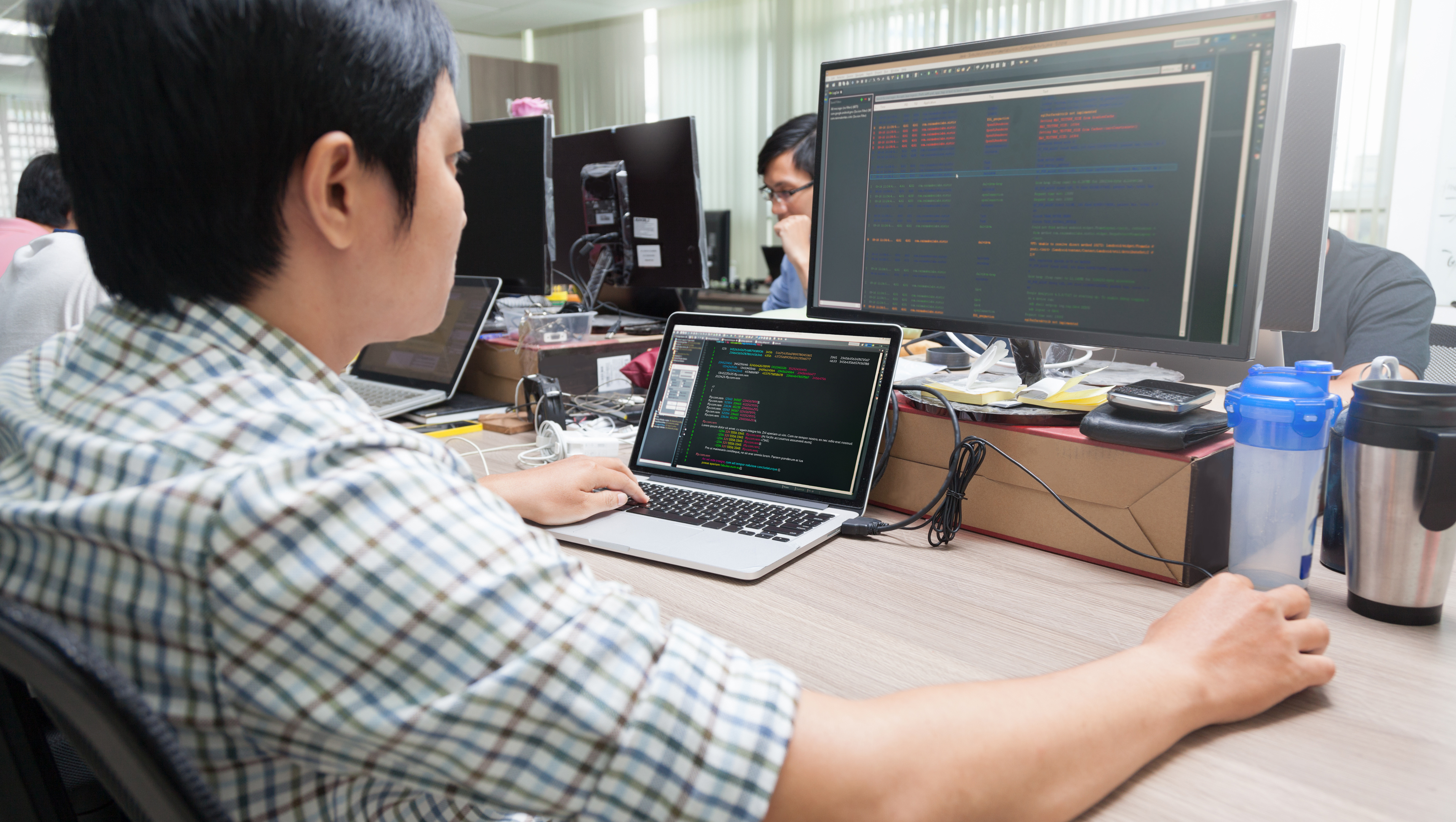 A System Administrator monitors the network from a computer screen.