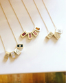 Tribe Birthstone Beads in Ruby, Rhodelite Garnet, Pink Tourmaline and Citrine (center necklace)