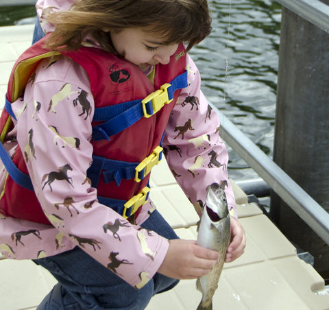 Cheyenne Herline catches her first fish.