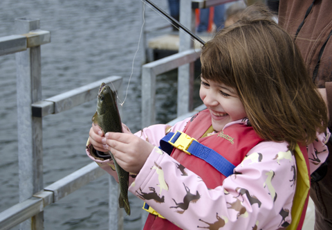Cheyenne Herline, 5, shows off her first fish.