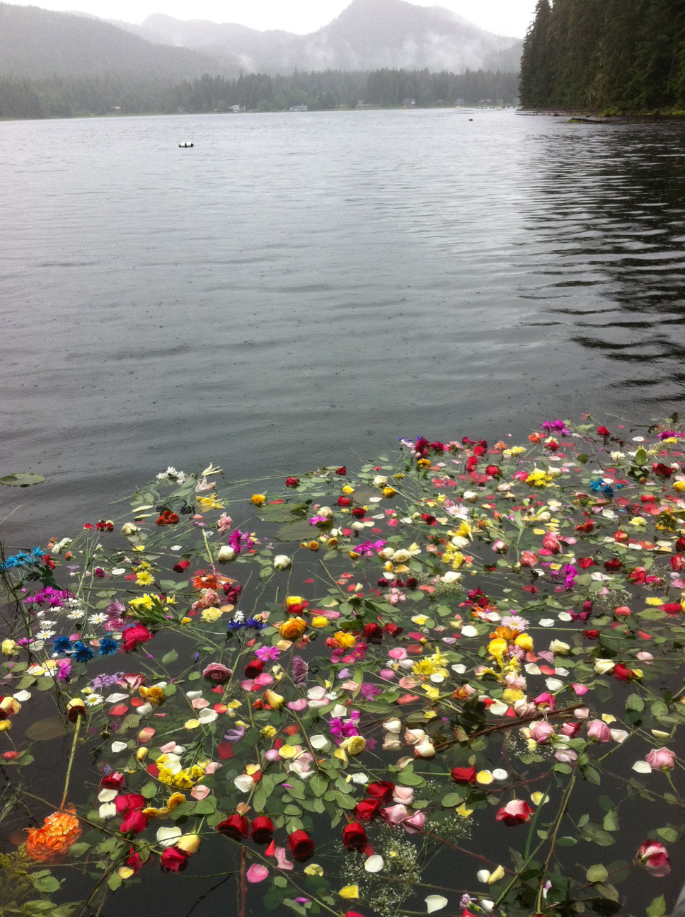 Flowers float on Auke Lake following the Monday memorial.