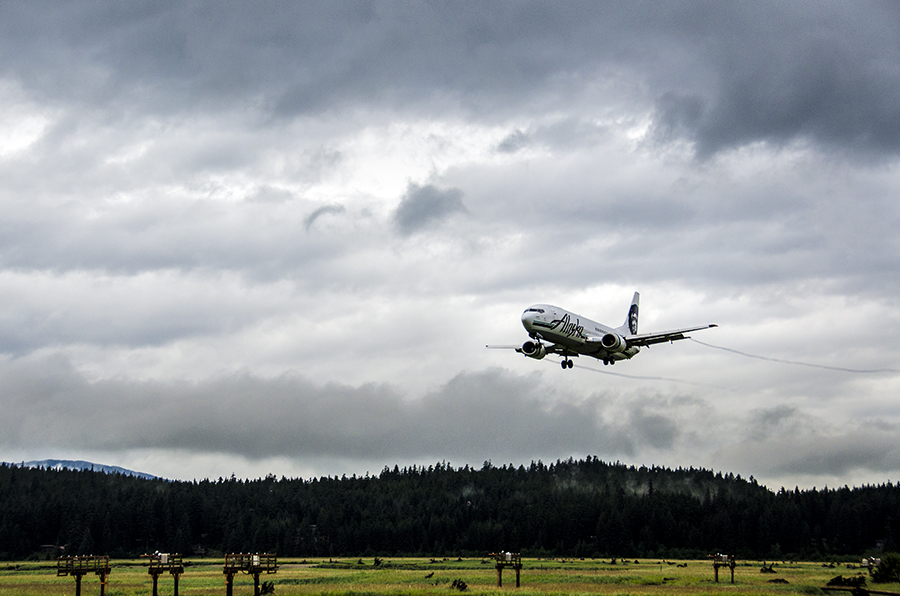 An Alaska Airlines flight comes in for a landing at the Juneau International Airport.