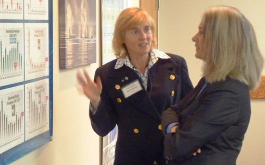 Science panel member Michelle Ridgway and Juneau Rep. Cathy Muñoz talk during the Cruise Ship Science Panel's technology open house Sept. 20 in Juneau.