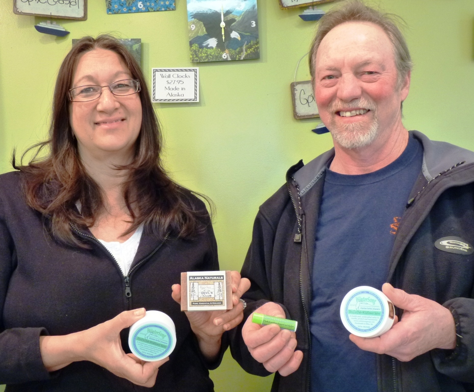 Wintersong owners Ruth and Gary McMasters hold their devil's club salve, lip balm and soap at their Sitka store.