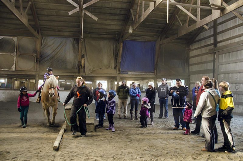 The first 4-H Pony Rides draws a crowd of eager children.