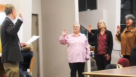 Superior Court Judge Phillip Pallenberg administers oath of office to newly elected Juneau School Board members Destiny Sargeant, Andi Story and Phyllis Carlson.
