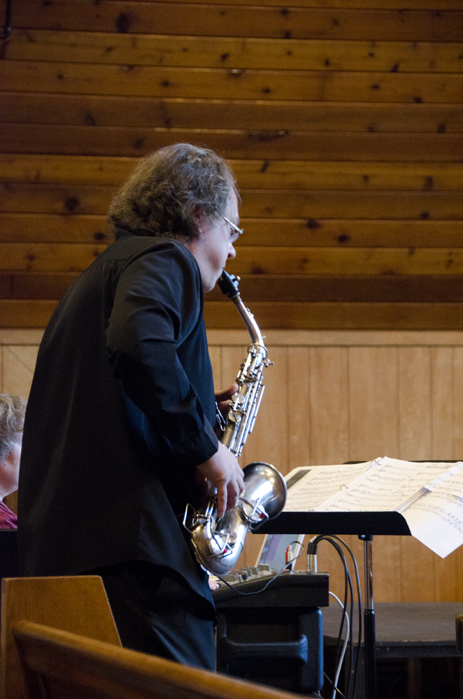 Opera to Go Artistic Director William Todd Hunt plays the saxophone to represent what Bennu sounds like.