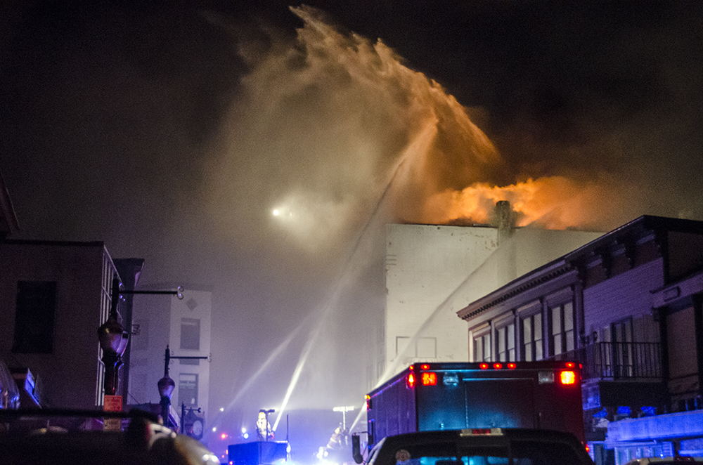 Firefighters battle the blaze. (Photo by Heather Bryant/KTOO)