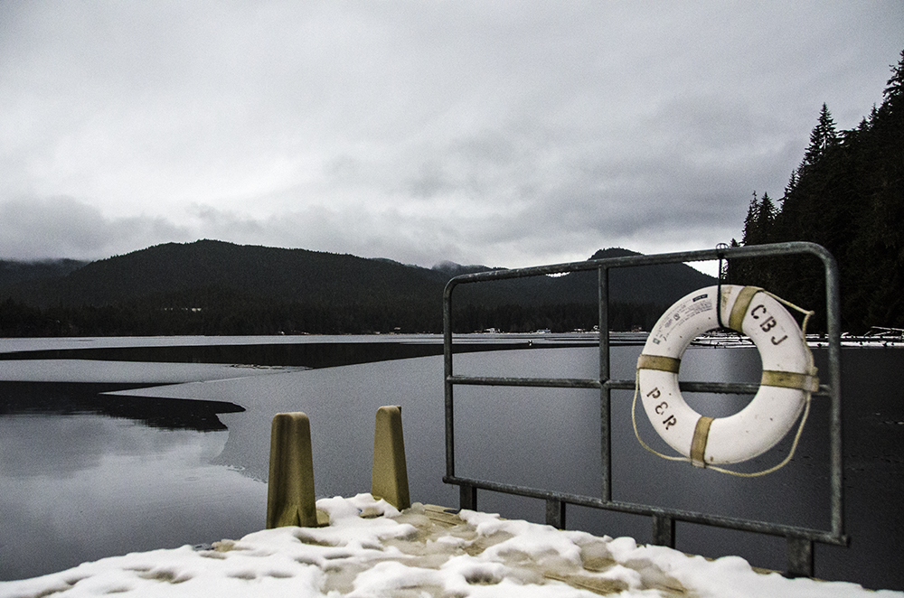 A CBJ Parks and Rec life ring hangs on the floating dock at Auke Lake.