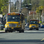 School buses line up to pick up students from school. (Photo by Heather Bryant/KTOO)