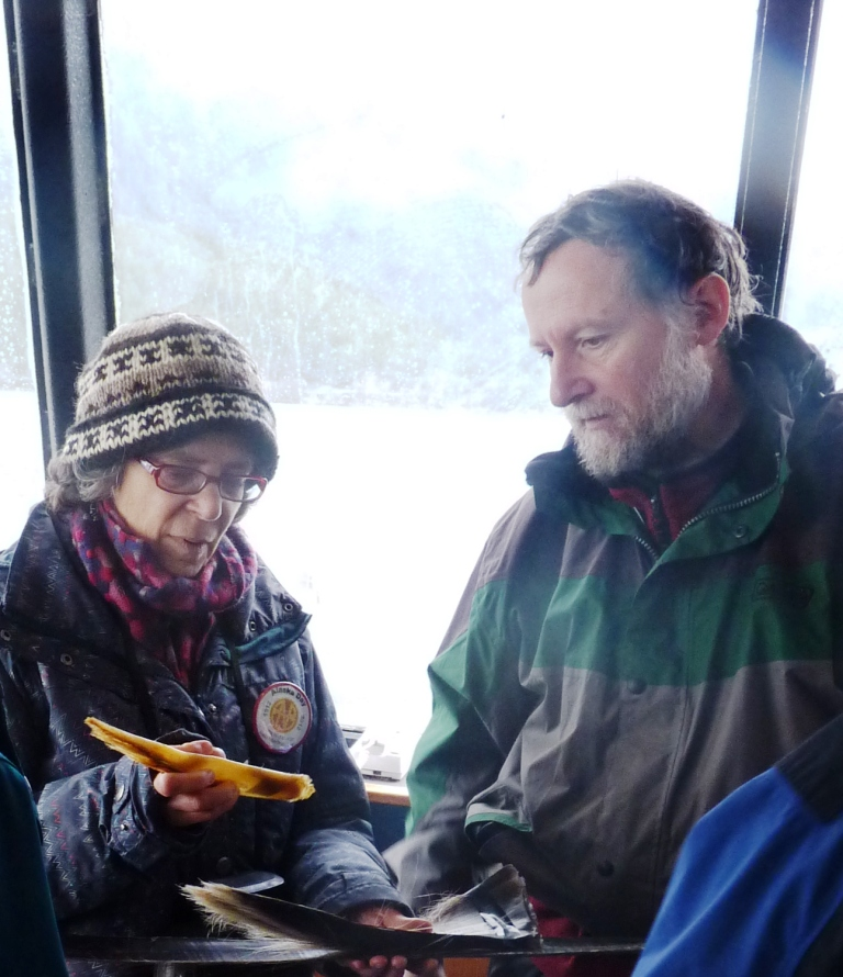 Humpback researcher Jan Straley shows whale baleen to a passenger during a Nov. 3 whale-watching tour in Sitka Sound.