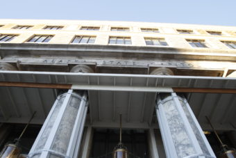A wooden platform above the doorway of the Alaska State Capitol Building protects entrants from falling debris from the portico.