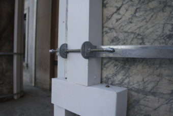 Wooden posts hold up the platform that protects people entering the Alaska State Capitol from falling masonry.
