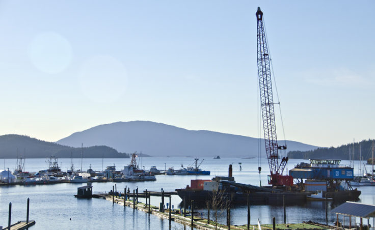 A construction barge is removing the DeHart's marina in Auke Bay this week. The work is the first phase of the Statter Harbor master plan.