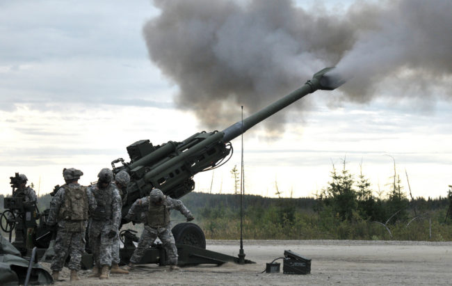Artillerymen with C Battery, 2nd Battalion, 8th Field Artillery Regiment, 1st Stryker Brigade Combat Team, 25th Infantry Division fire an M777 Howitzer during a live-fire exercise held at Fort Wainwright's firing range Aug. 7, 2012.The exercise certified non-commissioned officers on the ability to perform a fire mission with pin point accuracy and was part of the Artillerymen Advanced Leaders Course. (U.S. Army Photo By: Sgt. Thomas Duval, 1/25th SBCT Public Affairs)