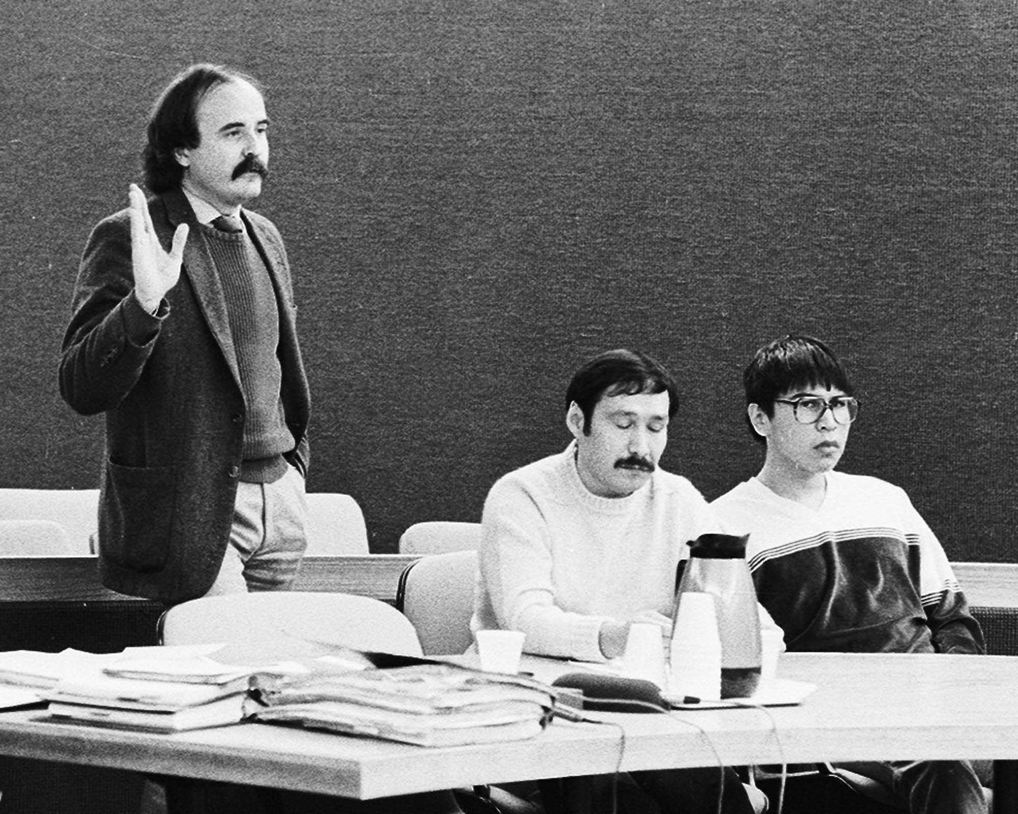 Defense attorney Ray Brown (left) addresses the court as Emanuel Tulles (center) and Newton Lambert (right) listen during a pre-trial hearing in the Benolken murder case. Photo by Brian Wallace.