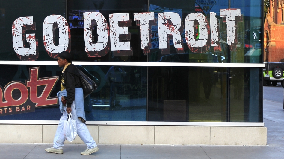 A pedestrian walks in downtown Detroit on Oct. 24, 2012. Carlos Osorio/AP