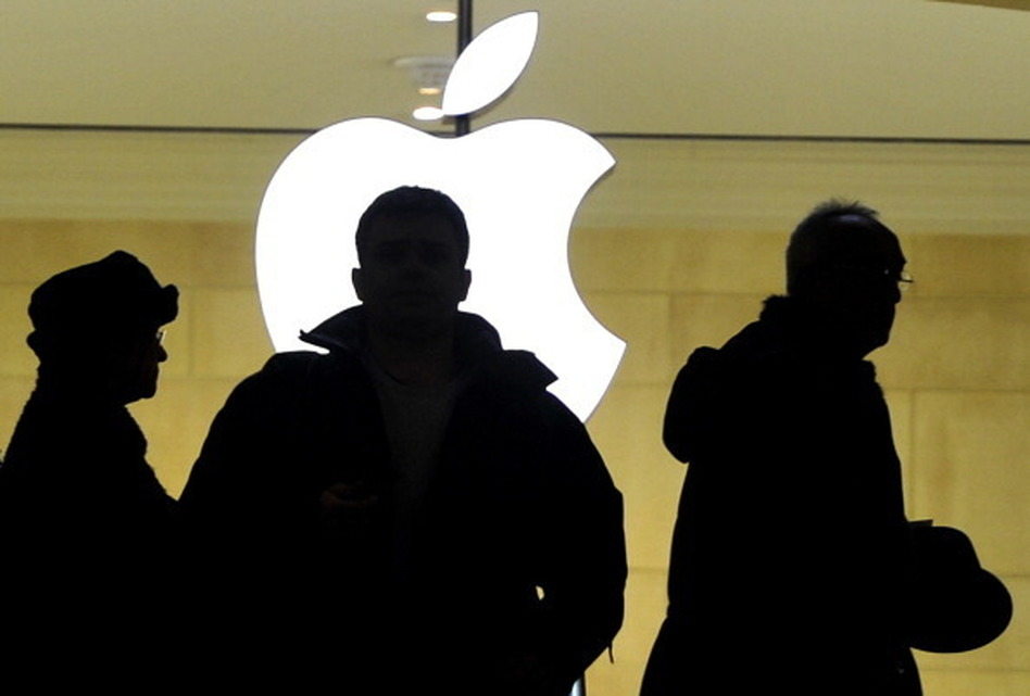 People walk past the Apple logo at the Apple Store at Grand Central Terminal in New York. Timothy A. Clary /AFP/Getty Images