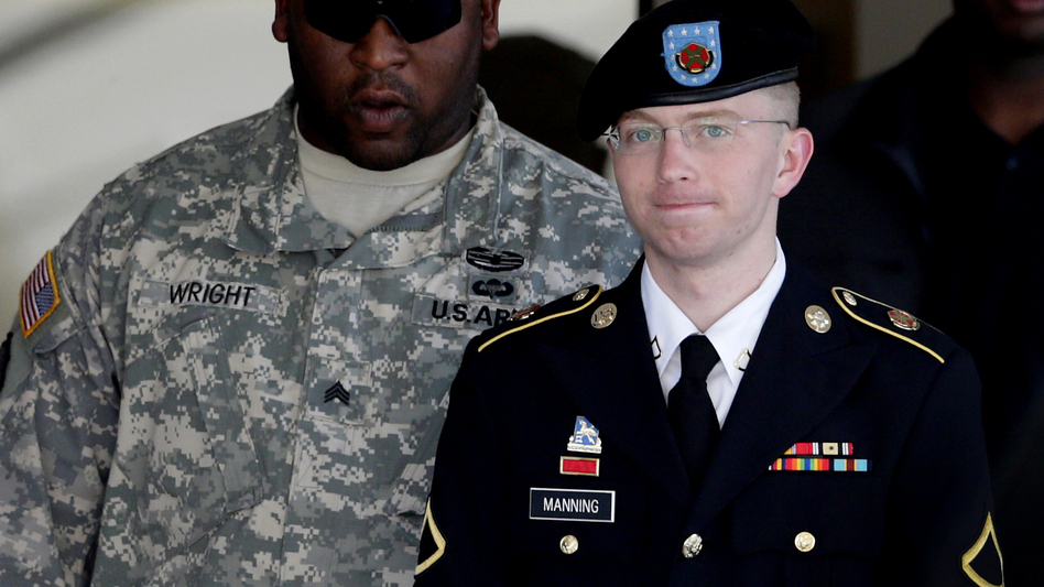 Army Pfc. Bradley Manning (right) is escorted out of a courthouse in Fort Meade, Md., on June 25, 2012. His lawyer announced that Manning, who is accused of leaking classified information to WikiLeaks, had agreed to plead guilty to lesser charges. Patrick Semansky/AP