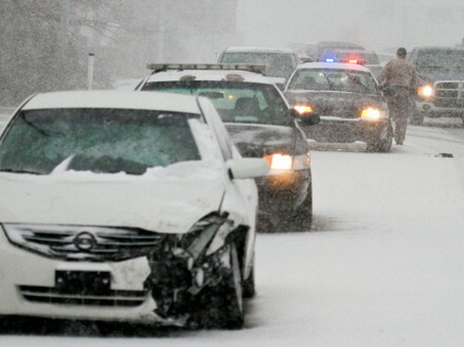 Snow-packed morning commute in Wichita on Wednesday. Wichita Eagle/MCT via Getty Images