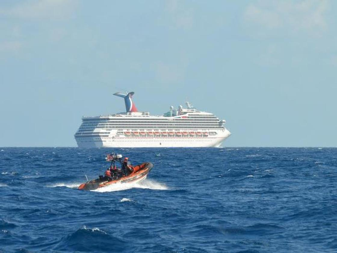 The Triumph cruise ship, set adrift in the Gulf of Mexico after an engine room fire Sunday, is being towed to Mobile, Alabama. The Carnival cruise ship line has cancelled the ship's next 14 voyages. (Photo by U.S. Coast Guard)