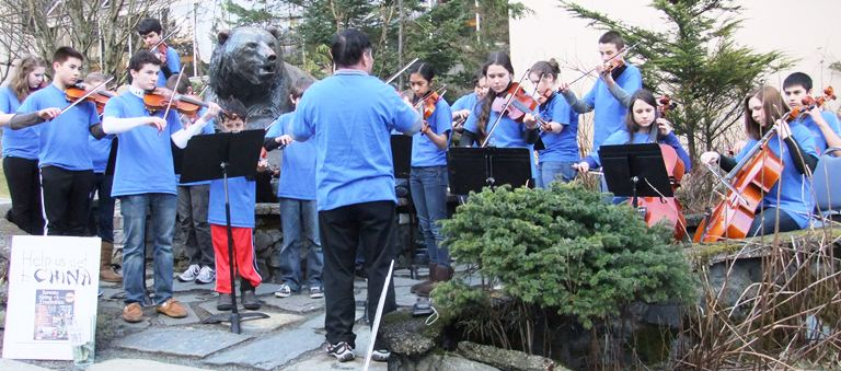 Juneau String Ensemble musicians play a late afternoon concert near the capitol building to raise funds for their upcoming trip to China.
