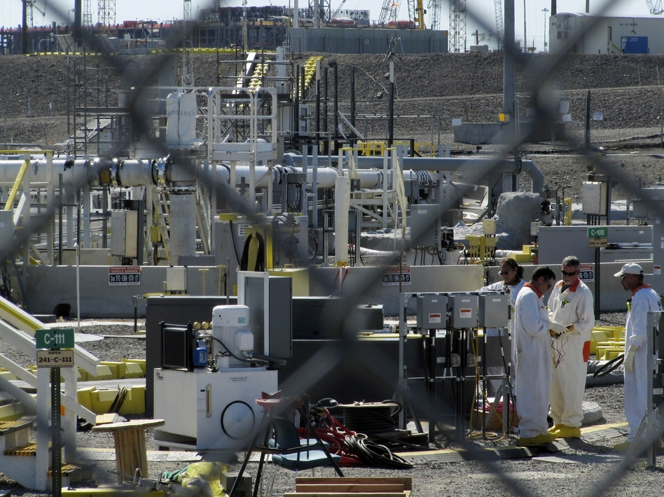 Workers at the Hanford Nuclear Reservation near Richland, Wash., in 2010. Shannon Dininny/AP