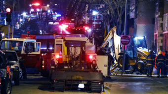 Fire fighters and utility workers at the scene of a massive gas explosion and fire Tuesday night in Kansas City, Mo. Orlin Wagner/AP