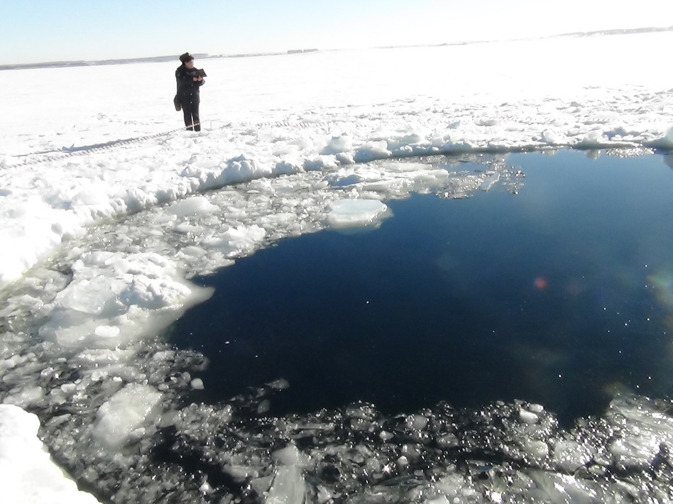 A circular hole in the ice of Chebarkul Lake, where the Chelyabinsk meteor reportedly struck on Feb. 15. Uncredited/Associated Press